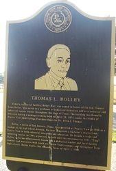THOMAS L. HOLLEY