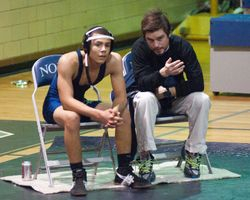 Coach discusses strategy with Grappler