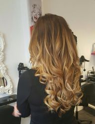 Human hair extensions with ombre
