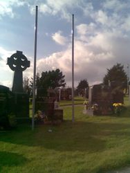 Eoin Morleys Grave with Flagpoles