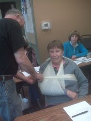 Using the Triangle Bandage to make A sling.  FIrst AId in the Wilderness Class