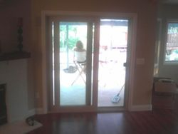 sliding glass door trimmed out with molding around it