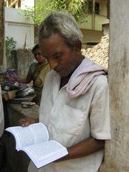 Reading Bible Yadayya (Ricksha puller)
