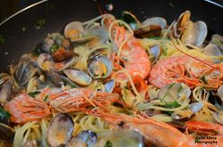 Colorful photo: Pasta with Vongole and Prawns.