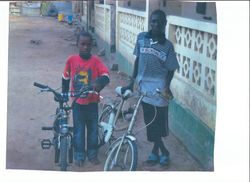 the children in africa receiving the bikes