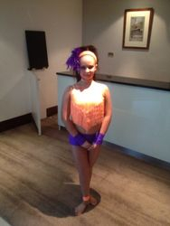 In her solo costume