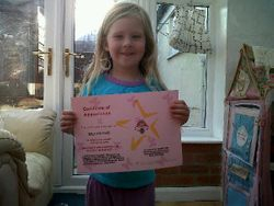 lucie fielding with her certificate x