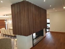 Fire Place under Wood cladding Wall