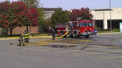 Firefighters getting ready for car fire.