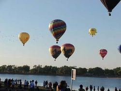 Cowboy Balloons Over Lake