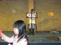 Tian Tian Playing Violin