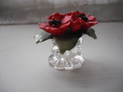 Glass vase with china flowers.