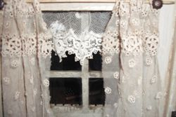 Very lovely lace at the windows.