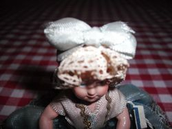 This hat is fixed to the dolls head!