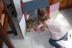 Ava playing with her new house.