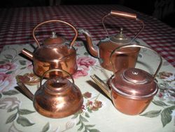 Very large copper kettles.