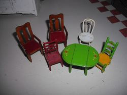 Tiny chairs and table.