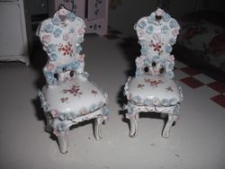 2 Very ornate porcelain chairs.