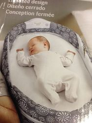 2. Snuggle Nest - Portable Infant Sleeper