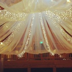 Tulle & Lights Hanging From Ceiling