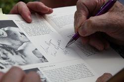 Sean regan signs fan book