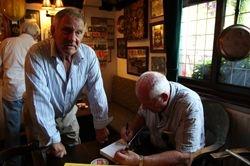 Sean Regan signing book for Frank Rimer