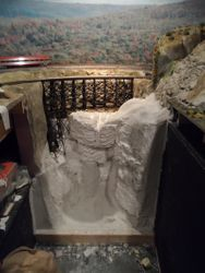 Plaster and rock formation slowly added.
