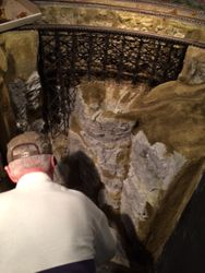 John Brown, who made the waterfall, is sitting it in place