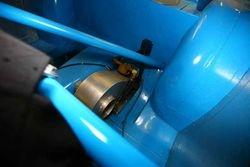 Transmission oil cooler behind driver's seat