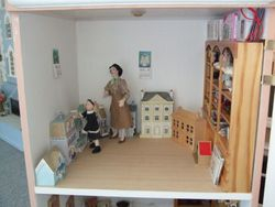 Upstairs - dolls' houses and dolls.