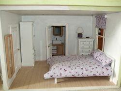 Bedroom and bathroom of basement flat.