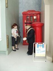 Post box and telephone kiosk