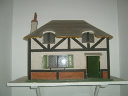 The Queen's Dolls House 1922-30. Dimensions: 26 inches [66 cm] wide, 16 inches [40.5 cm] deep and 19 inches [48.5 cm] high.