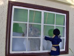Vlad was gloomily looking out of the attic window when his attention was caught by a small figure wearing a beret and tapping crossly on the window.