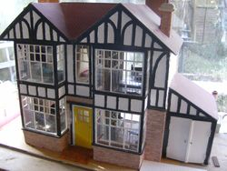 Now for the outside. I am thinking of putting real bricks where it is just paper now.