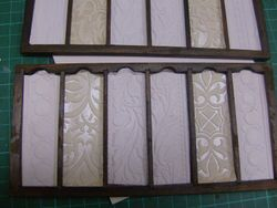 I have filled the remaining slide drawers with Anaglypta paper.