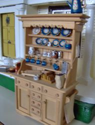 This is a white Chrysabon set painted up in blue and gold to represent Wedgewood. One plate got missed out on the blue and the big pot on top is old Dol-toi.