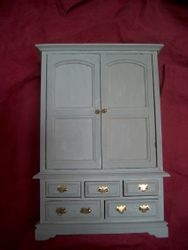 Same design, different drawer handles.