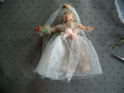 Here is the bride, redressed with old net and old wool cummerbund and old silk rose.