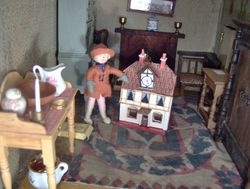 Angelica went up to the old nursery to say Goodbye to her dolls' house.