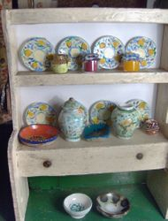 The kitchen dressers bloomed with these colourful objects......