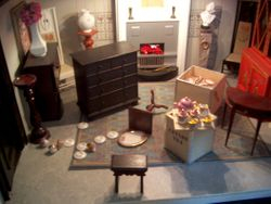 That midnight something toppled the beautiful Dresden tea set in the back show room.