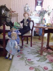 As he replaced the receiver he became aware of Fiona and her grubby little sister stealing cakes from the cake stand.