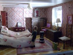Norah was finishing making the bed in one of the main bedrooms.