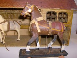 The third horse, awaiting a wheel - he has a button there at the moment, and I will try to drill a hole through so he may roll again.