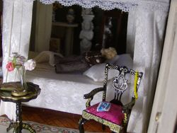 Meanwhile the object of her thoughts had crept into her bedroom and was lying with his boots upon the clean white bedspread as he lay contemplating his reflection in the full-length mirror set in the canopy of the bed,