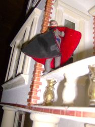 But all thoughts of a cosy cup of cocoa fled from his mind as he watched horrorstruck as the vile creature wrapped a cloak around itself, and, taking flight, headed straight for the balcony of Puggsley House.