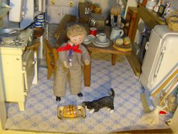 They went into the kitchen and Oscar noticed that a pack of sausages, still in their wrapping, were in a baking tin on the floor and Edith's bird loving cat was rapidly approaching the tasty bundle.