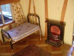 Old fireplace and warwick miniatures bed,