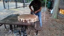 Sanding the log